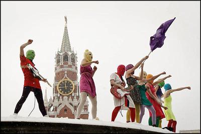 Eight women stood in a line opposite the Kremlin, neon balaclavas hiding ...